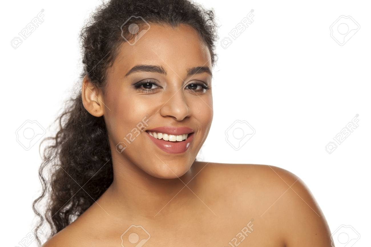 portrait of young beautiful dark-skinned woman on a white background - 121335640