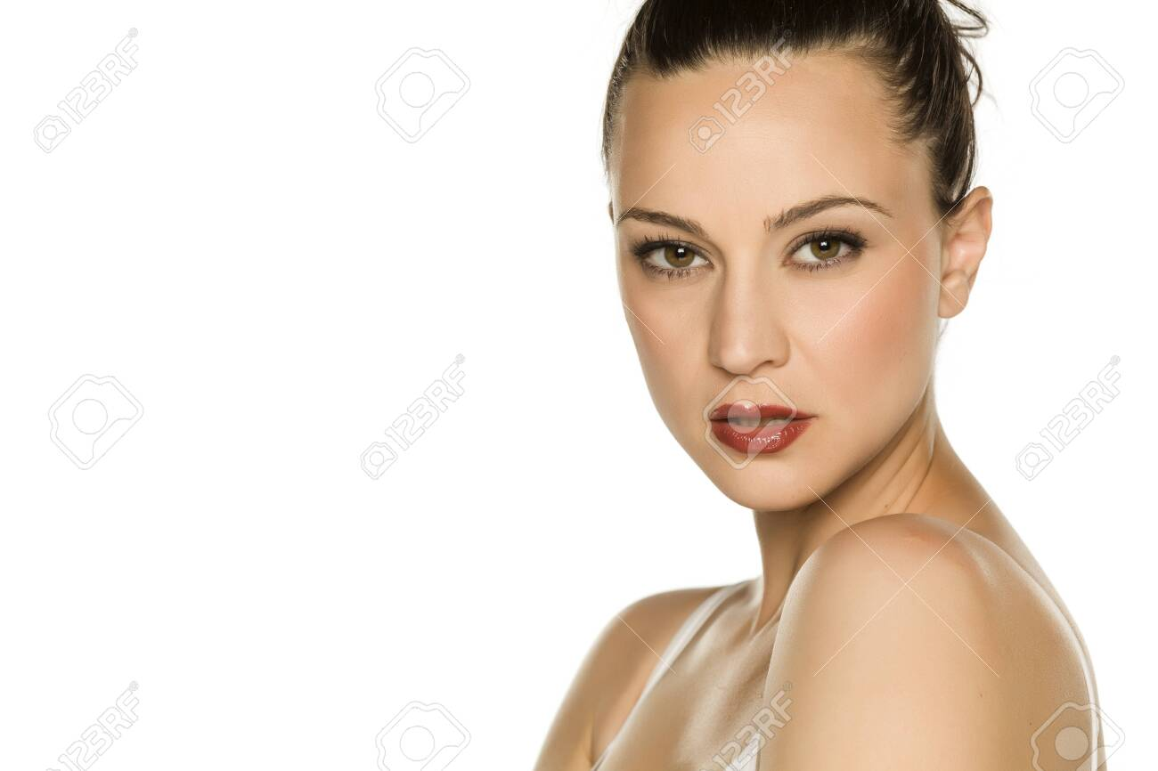 Portrait of beautiful young woman on white background - 130544212