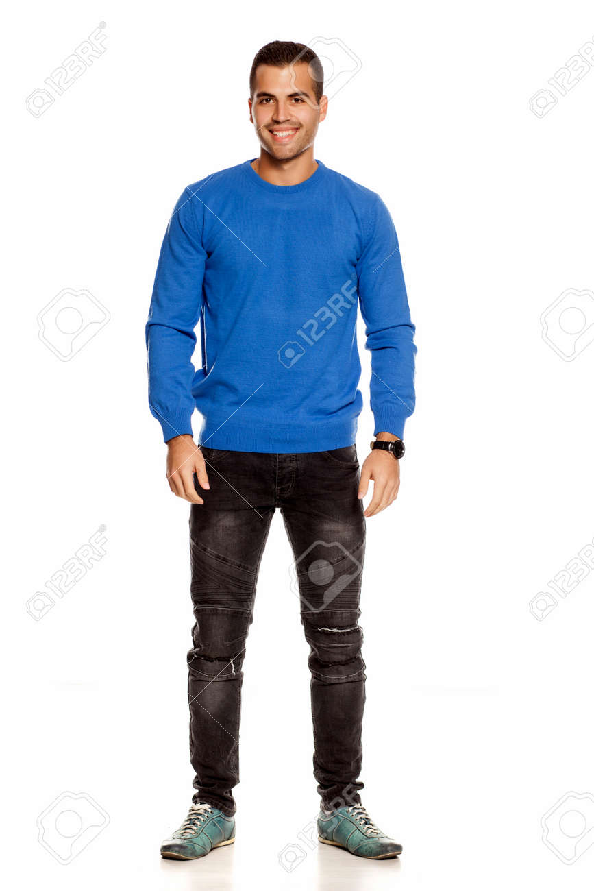 handsome happy young man in blouse and jeans on white background - 156134866