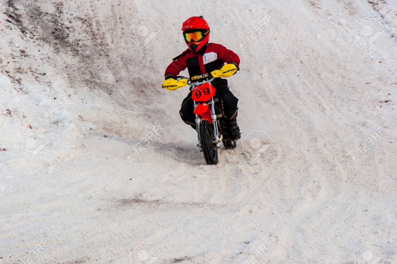 Winter Motocross competitions among children Stock Photo - 18468835