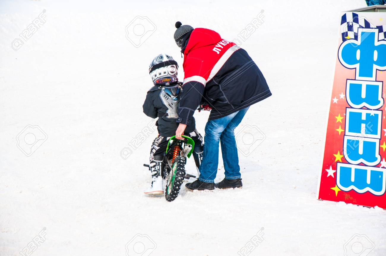 Winter Motocross competitions among children Stock Photo - 18468821