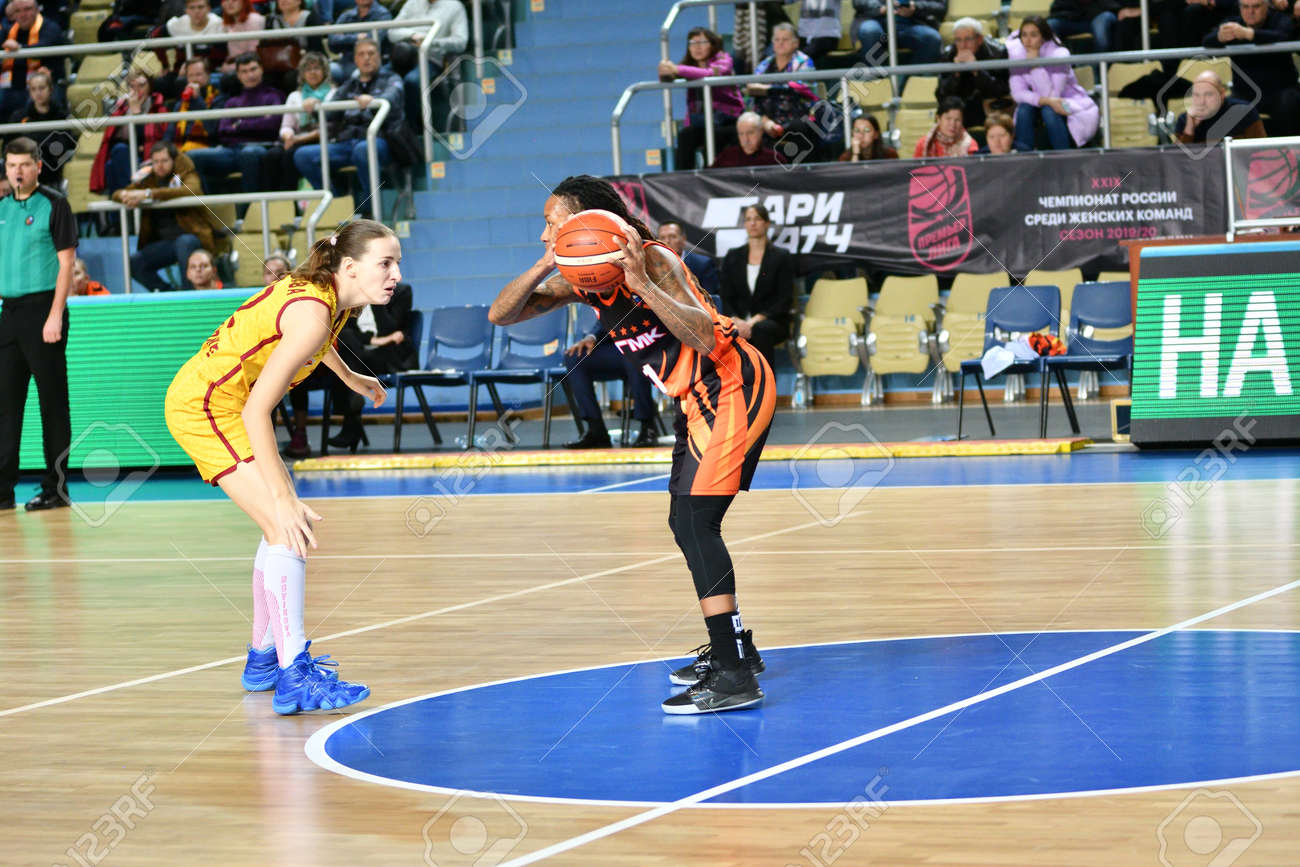 "Orenburg, Russia - November 24, 2019: Girls play basketball in the Russian championship match between the basketball clubs ""Hope"" (Orenburg) and ""UMMC"" (Ekaterinburg) - 169310546"