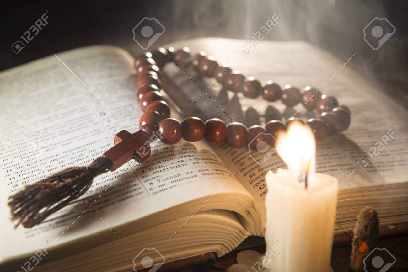candle with incense and holy book - 46808468