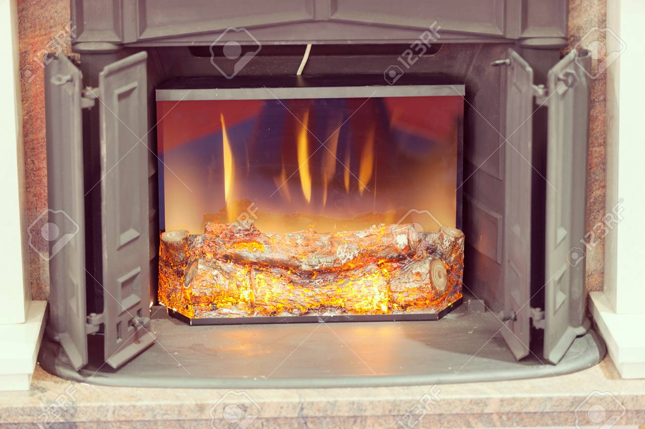 fake fireplace with a fire effect, note shallow depth of field