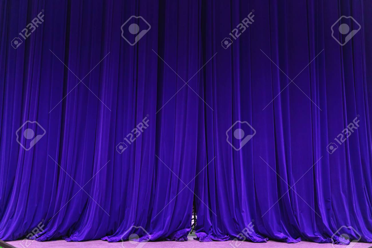 closed blue curtain background spotlight beam illuminated. Theatrical drapes. Wallpaper design - 125225887