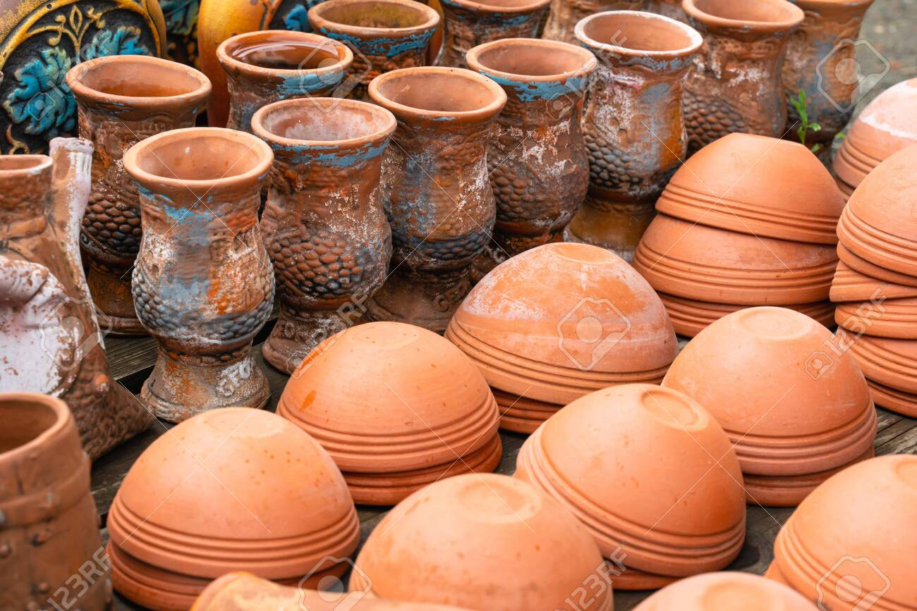Many Cutlery Is Made Of Clay. Ceramics And Handwork Close-up.template For  Website Or Banner Stock Photo, Picture And Royalty Free Image. Image  131465470.