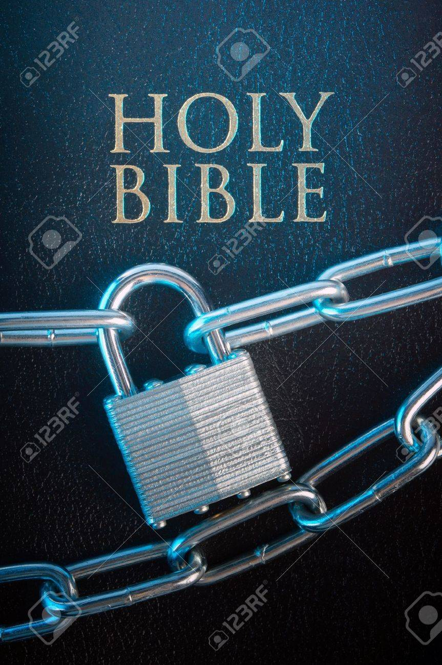 Bible closed with a chain lock on a close-up Stock Photo - 11967483