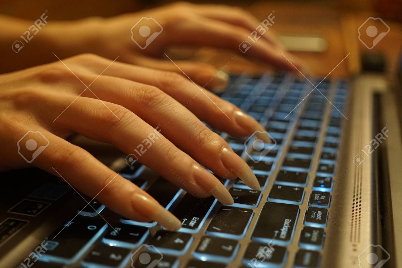 Women\'s Hands With Long Natural Nails Type On Computer Keyboard ...
