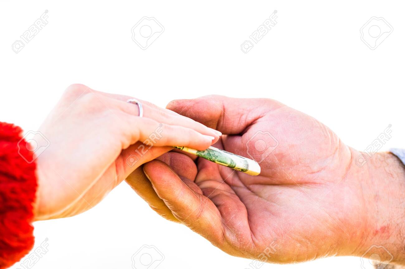 Hand giving money like bribe or tips isolated, hard worked hand taking dollars money. Currency transfer on white background. Reward for hard work. - 136124383