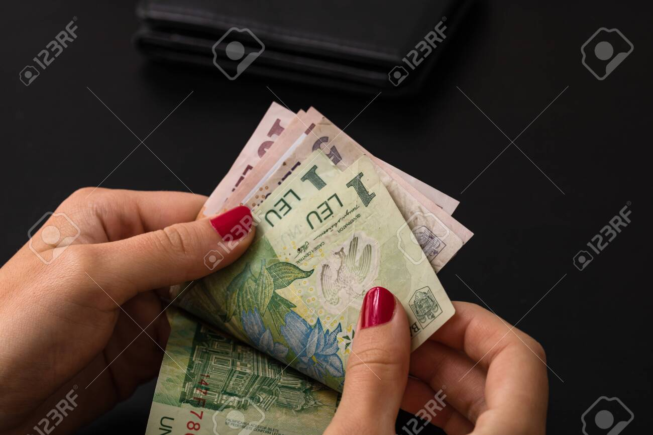 Woman counting money, counting LEI close up - 143645745