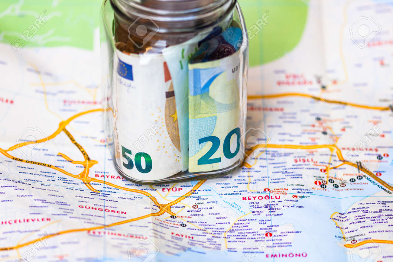 Composition with saving money banknotes in a glass jar. Concept of investing and keeping money for dreams and travel, close up isolated. - 158199153