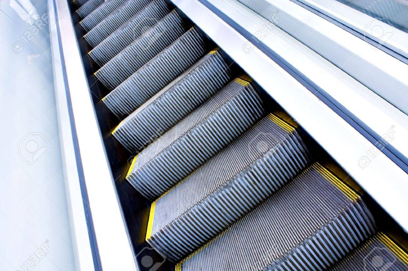 Moving escalator in the office hall perspective view Stock Photo - 5106385