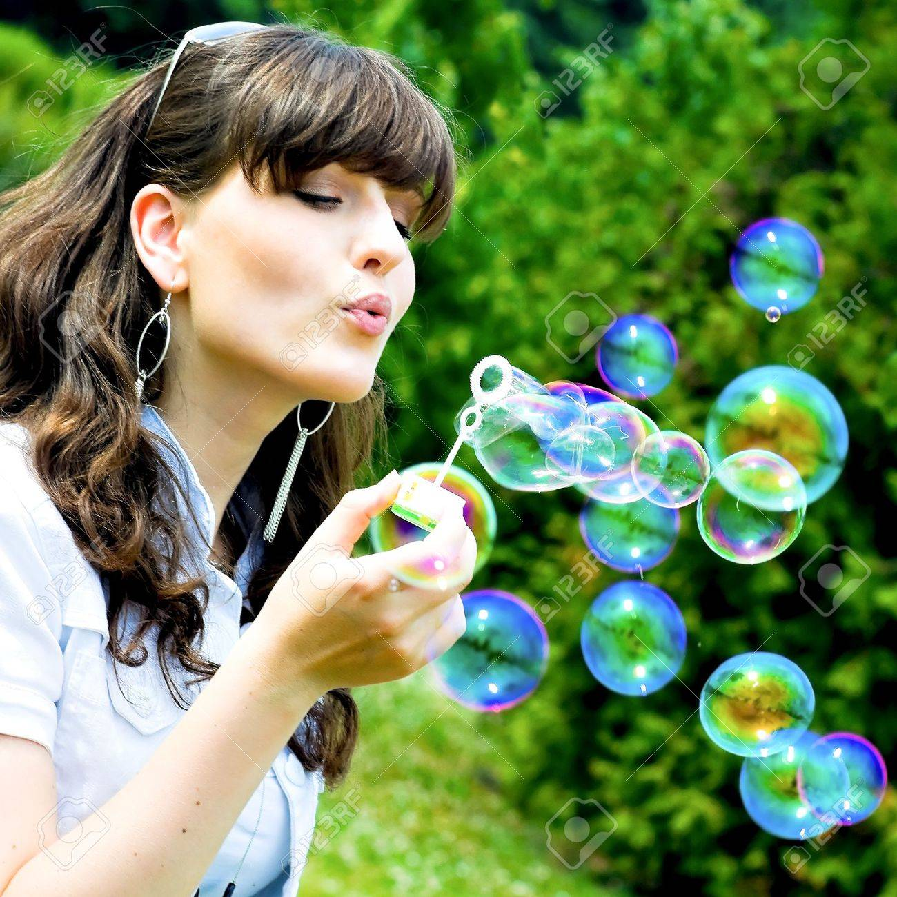 attractive girl blowing soap bubbles in summer green park Stock Photo - 5676060