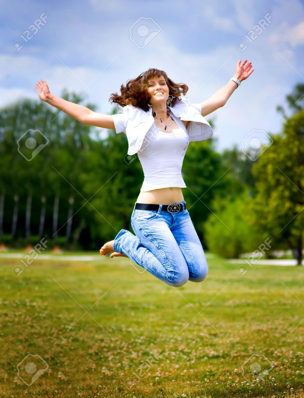 Happy Jumping Girl Stock Photo, Picture And Royalty Free Image. Image  6959421.