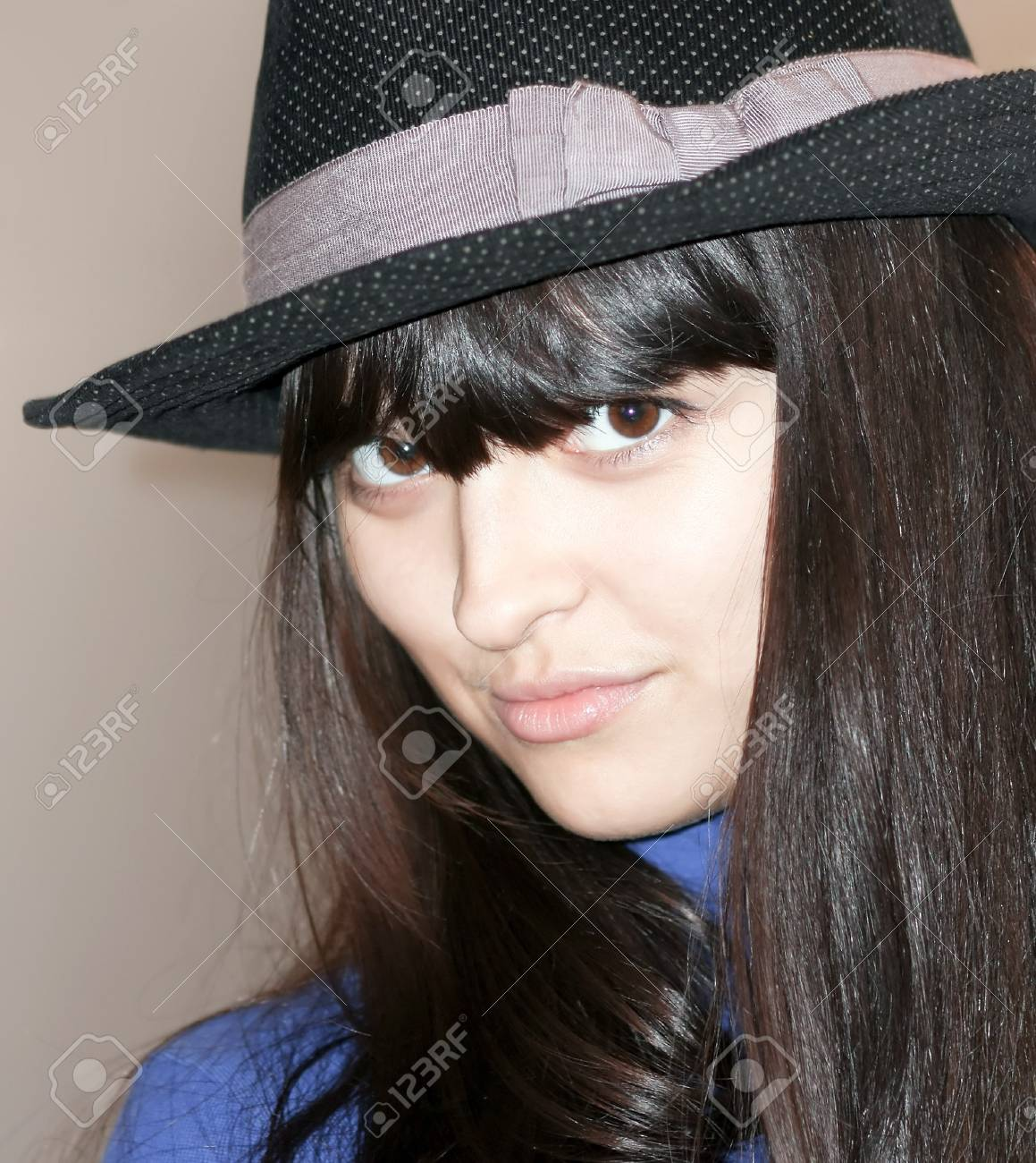 cool sexy girl with beautiful hat looking Stock Photo - 8156597