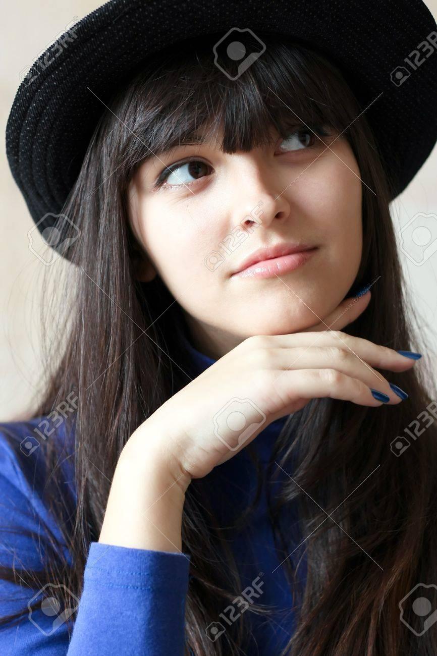 cute pretty woman in pensiveness Stock Photo - 8156566