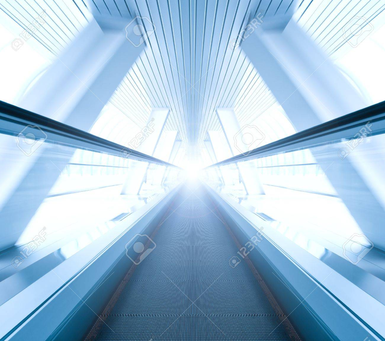 wide angle of moving symmetric escalator inside contemporary airport Stock Photo - 8930922