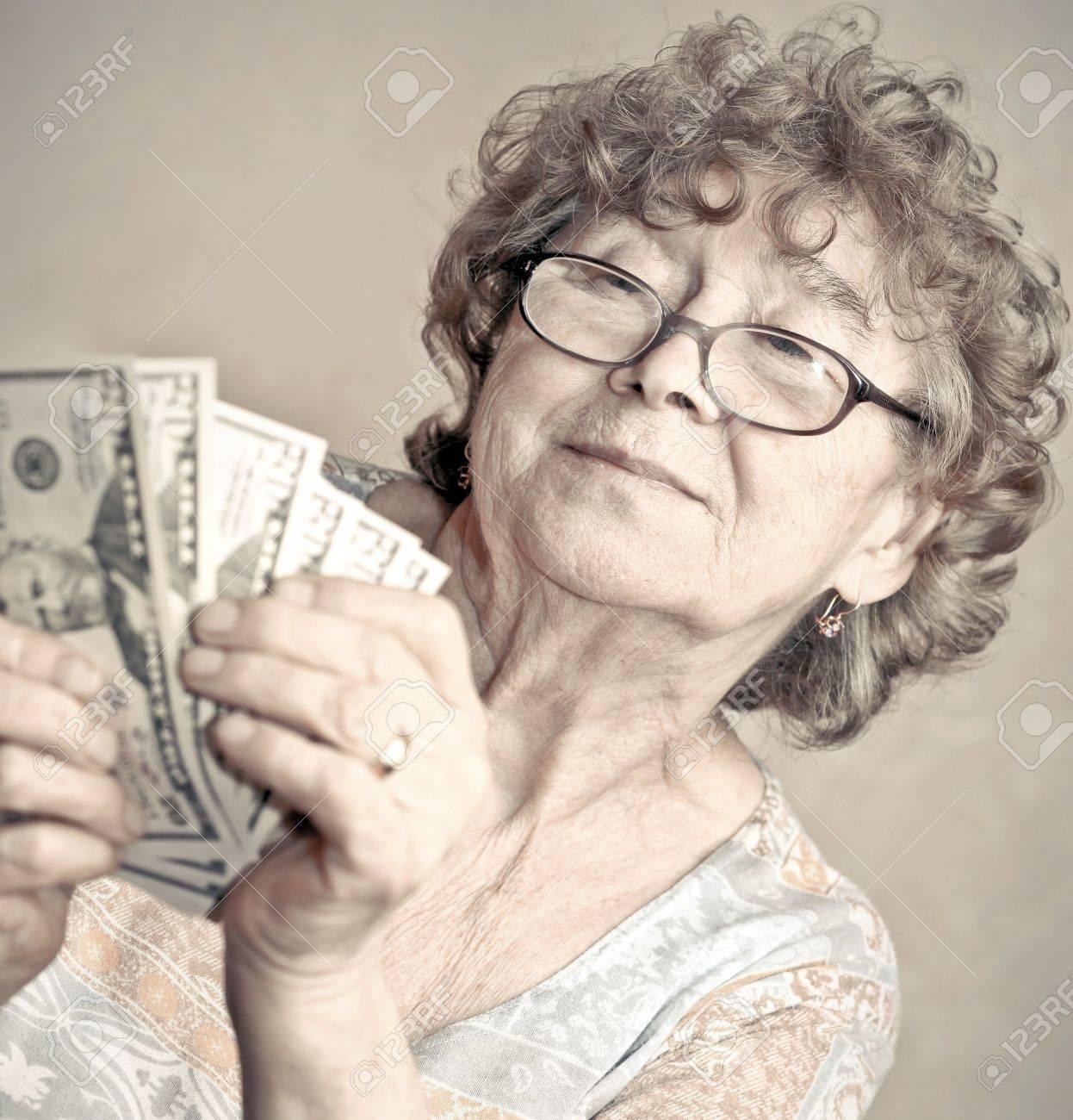 senior happy woman with money Stock Photo - 19312241