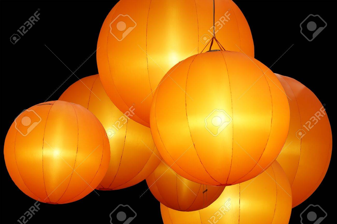 warmly colored balloon lamps isolated on black background Stock Photo - 11318992