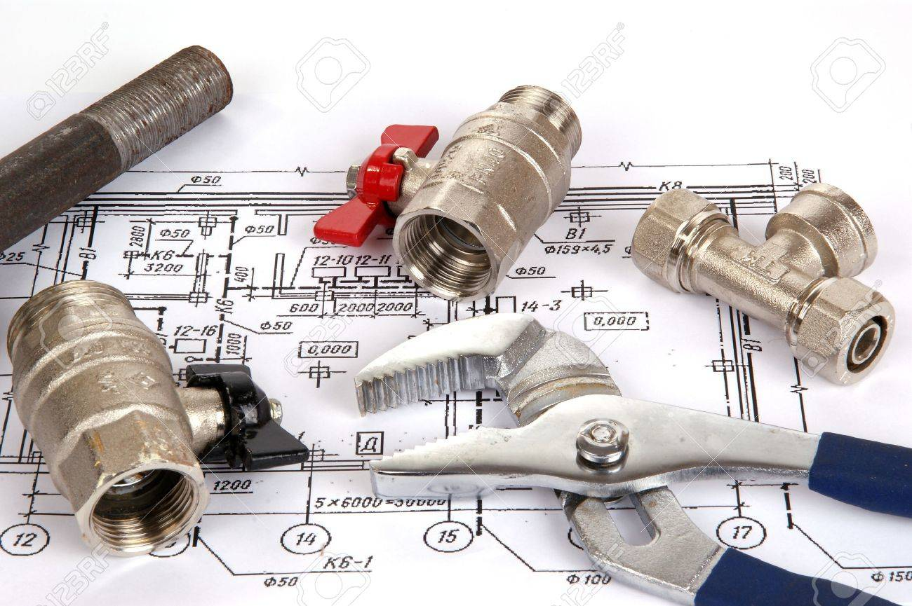 Plumbing Parts And Tools For Drawing Closeup Stock Photo