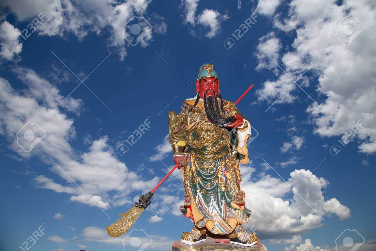 Dharmapala (protector of dharma), Buddhist temple in Beijing, China.  Dharmapala is a type of wrathful deity. The name means Dharma-defender in Sanskrit, also known as the Defenders of the Law (Dharma), or the Protectors of the Law Stock Photo - 24616595