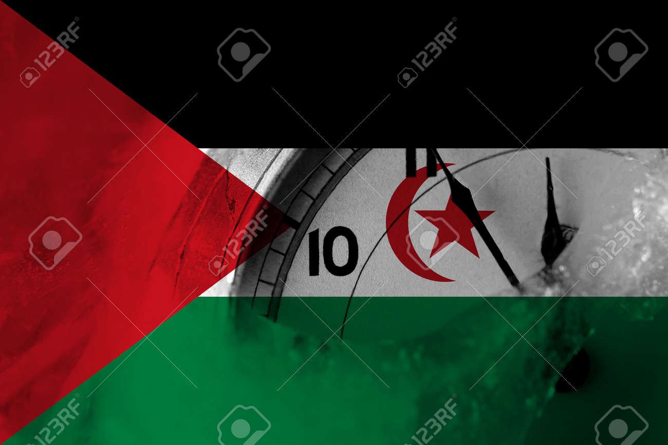 Sahrawi flag with clock close to midnight in the background. Happy New Year concept - 160105014