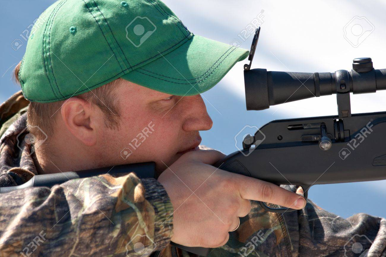 Close up hunter aiming with weapon at the outdoor hunting Stock Photo - 10350485