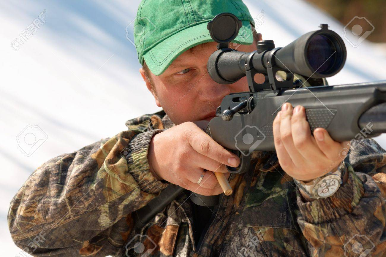 Close up hunter aiming with weapon at the outdoor hunting Stock Photo - 10350480