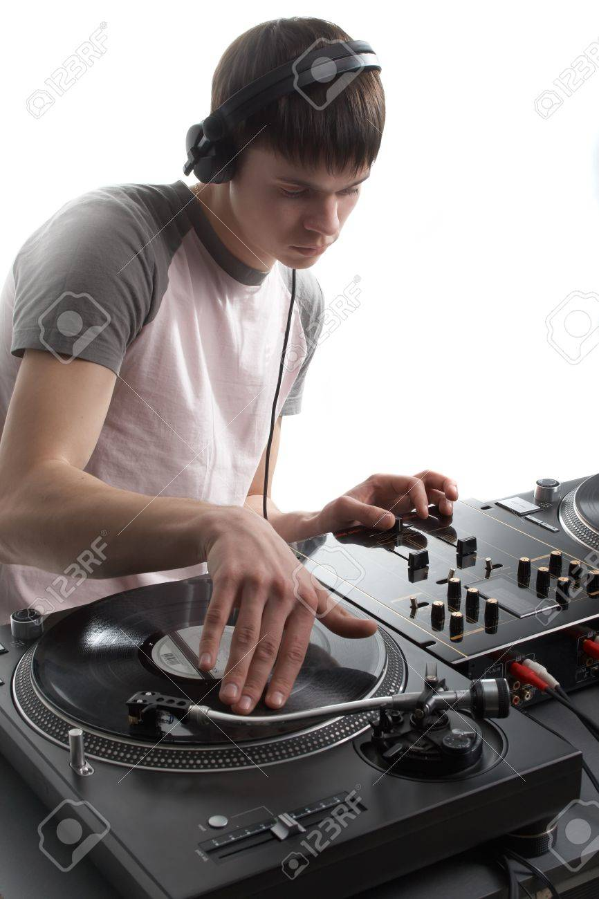 Young disk jockey for thw vinyl disks and mixer Stock Photo - 12269903