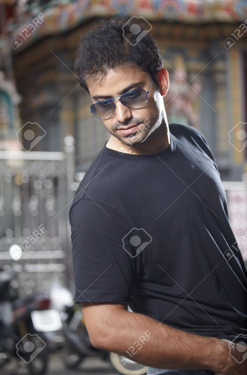 Portrait handsome indian man in sunglasses at the street Stock Photo - 14658374