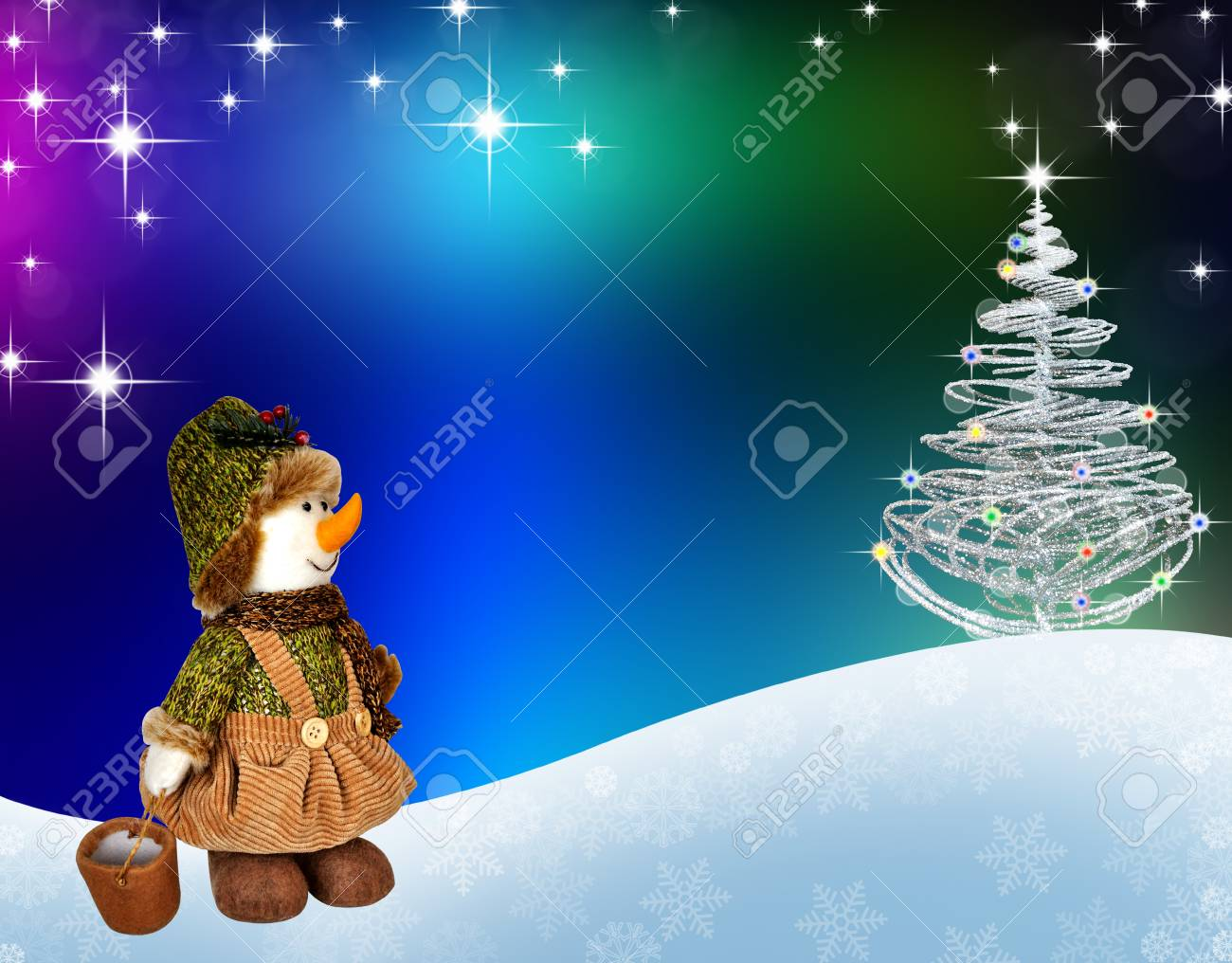Snowman On The Background Of Christmas Tree And Greetings In Stock