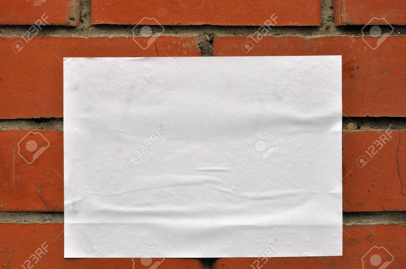 A sheet of clean white paper on the wall from red brick - 59499876