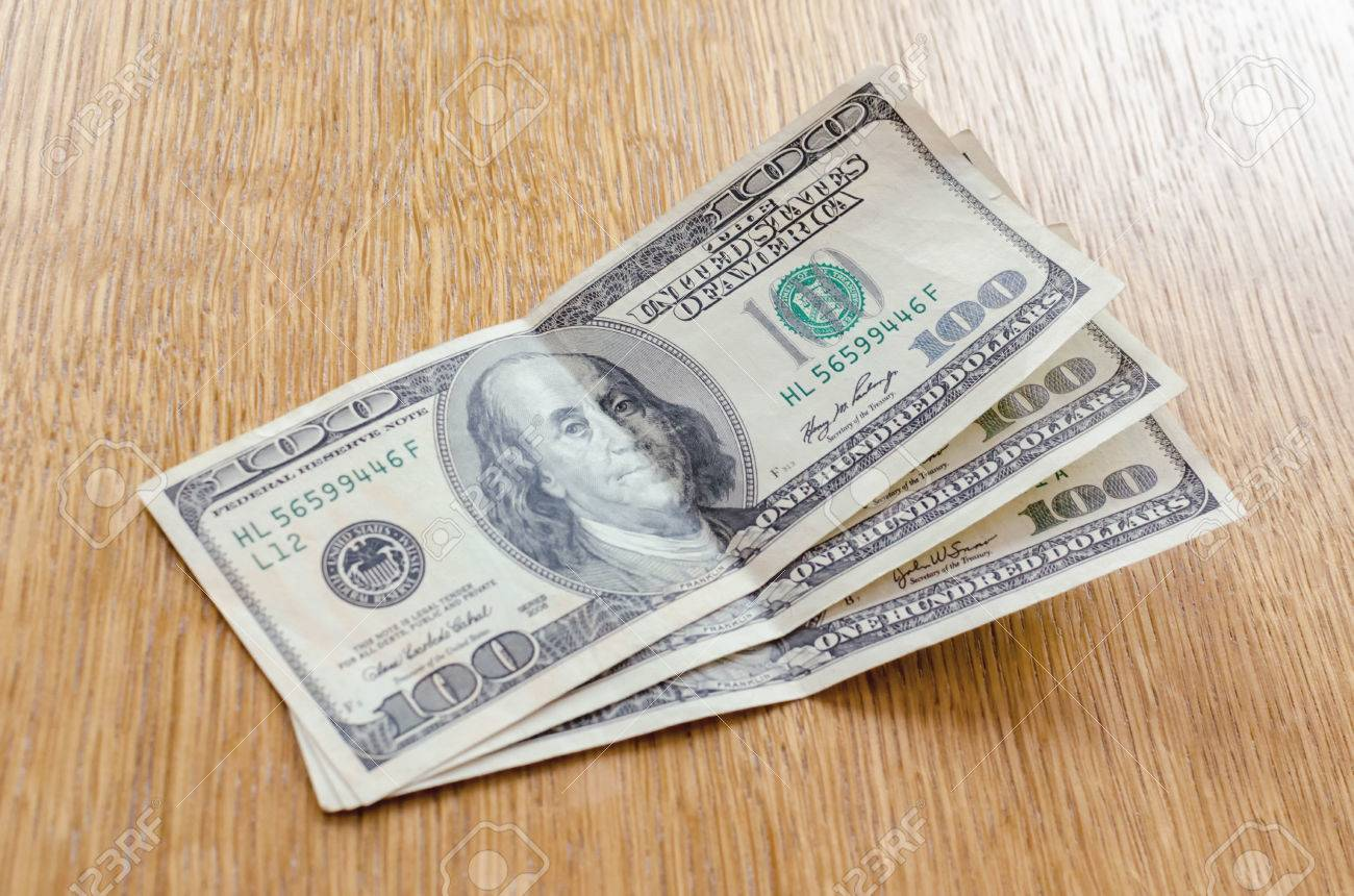 three hundred dollars  Three Hundred Dollars On The Table Stock Photo, Picture And Royalty ...