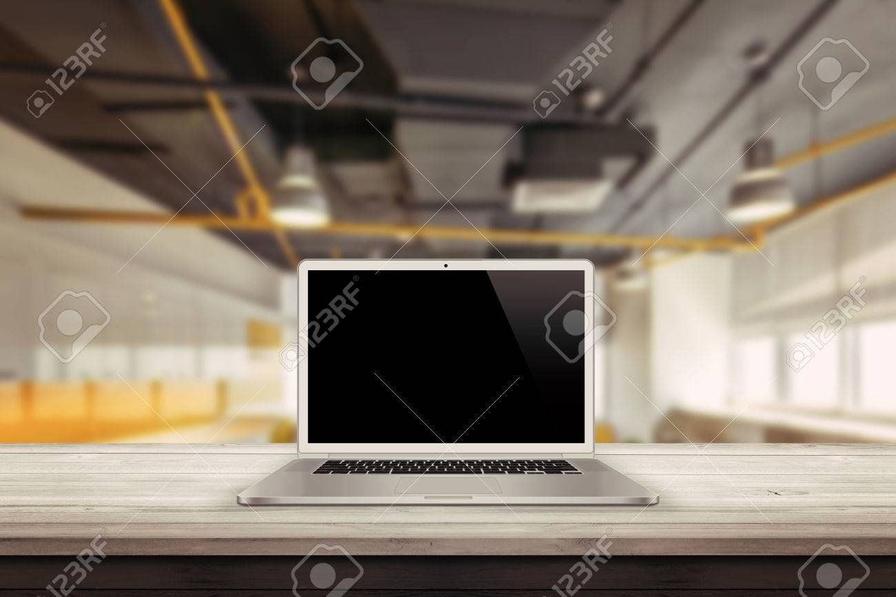 white laptop on the desk in the office mockup presentation Standard-Bild - 47041430