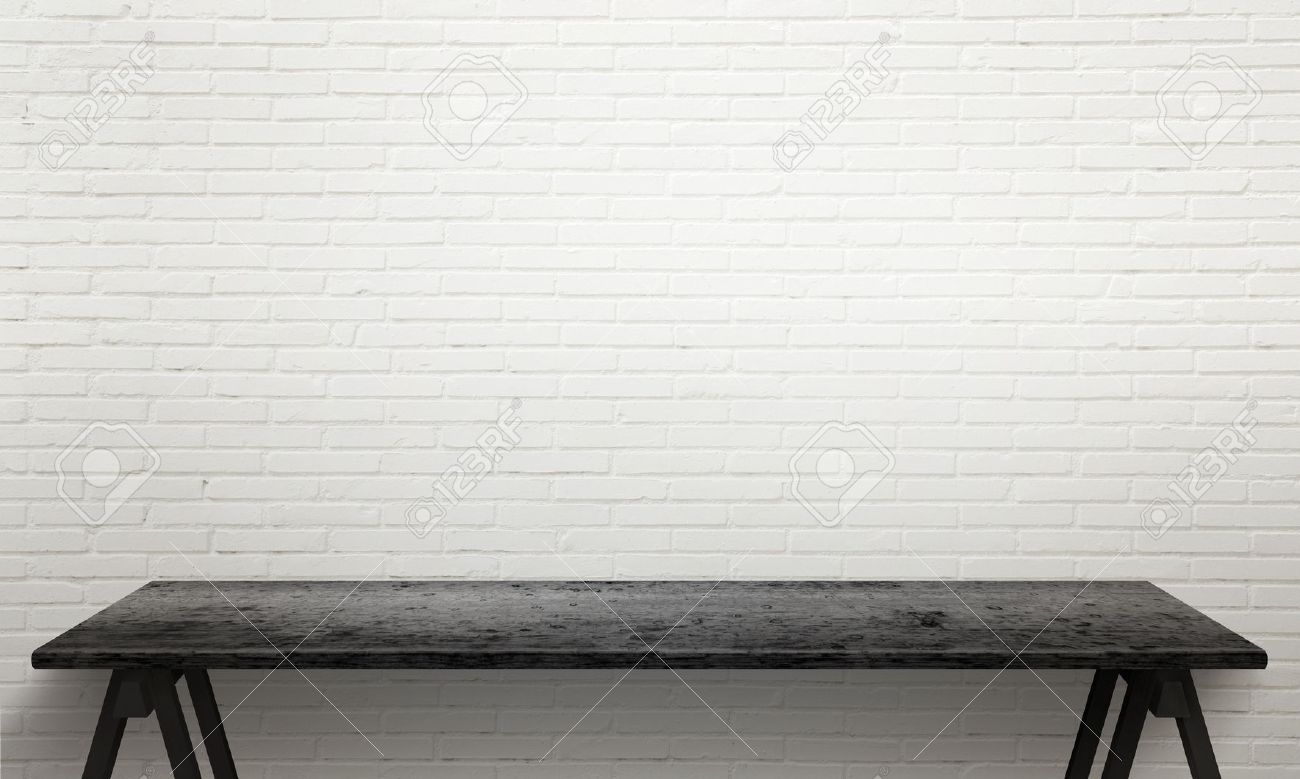 White wooden table texture - Black Wooden Table With Legs White Brick Wall Texture In Background Stock Photo