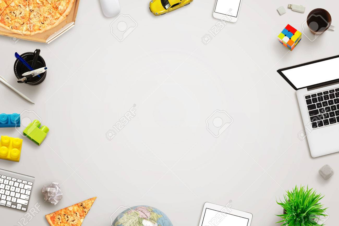 Top View Of Work Desk With Free Space For Text Surrounded With