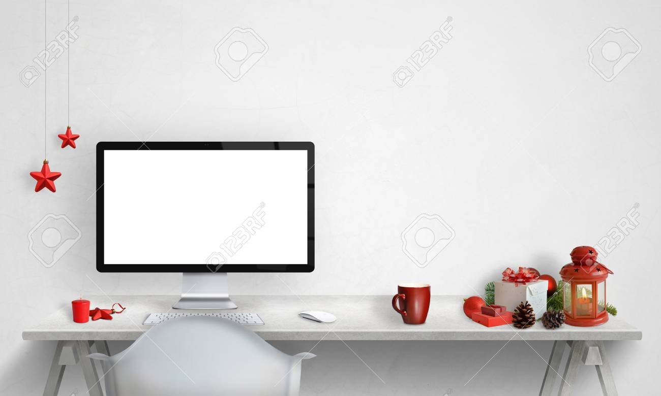 Computer display mockup with Christmas decorations beside  Free