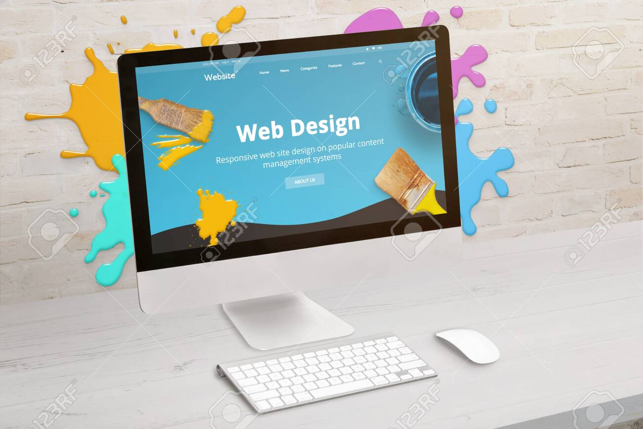 Concept of web design studio with coimputer display and color drops on brick wall. Modern web design teme on screen. Concept of modern graphic studio desk. - 126884173