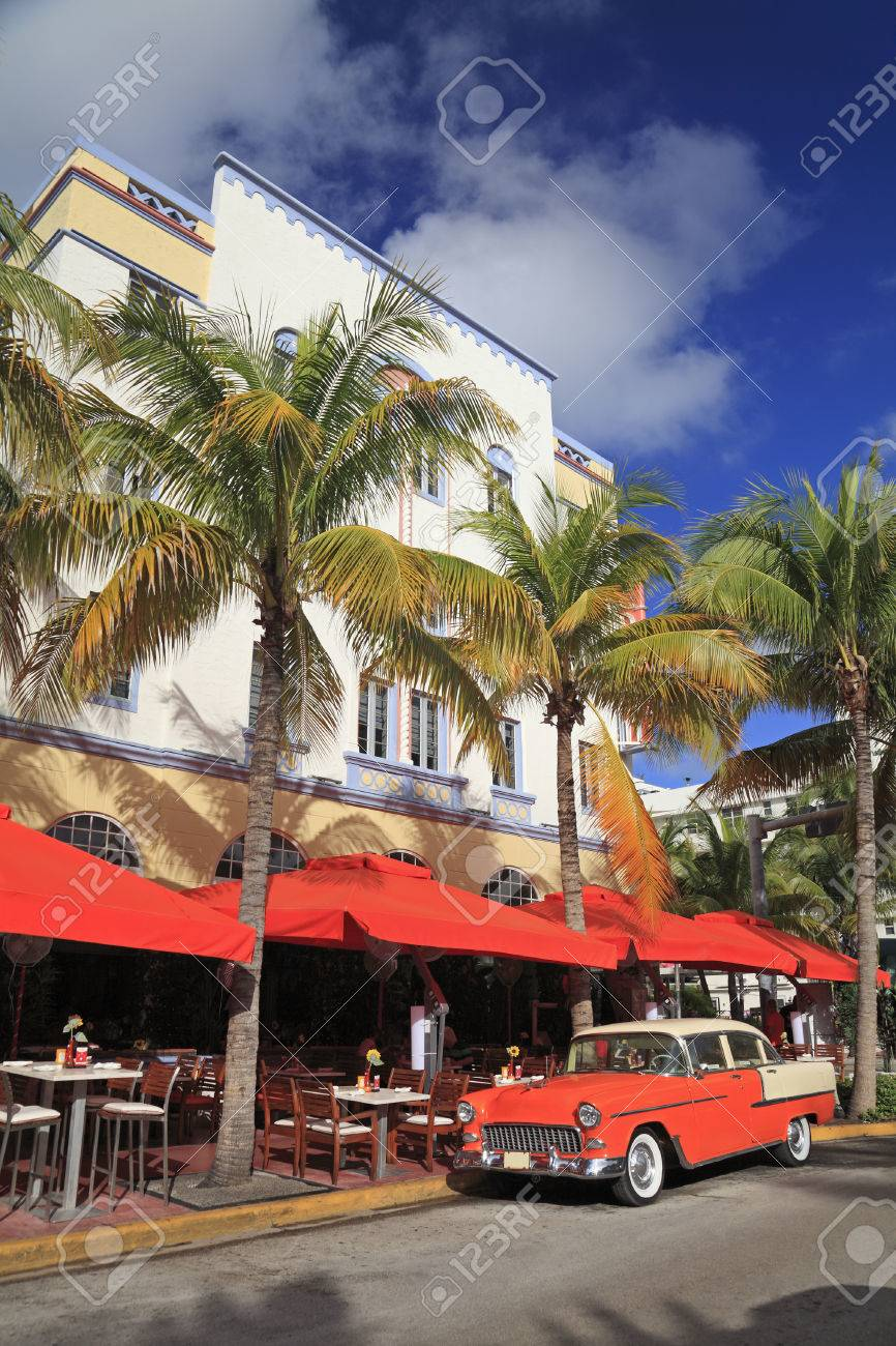 Old Car And Restaurants On Ocean Drive The Major Thoroughfare