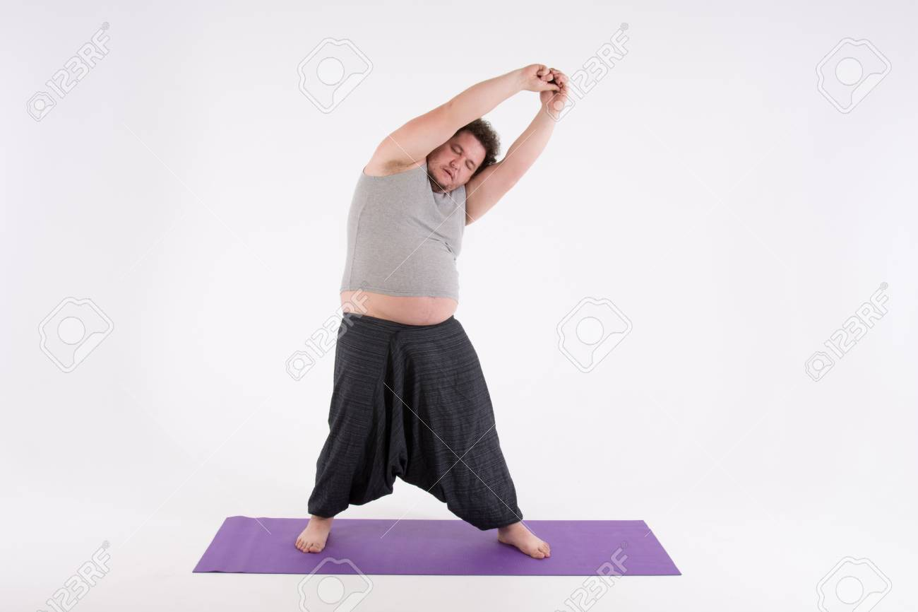 Funny Fat Man And Yoga Sport Diet A Healthy Lifestyle Stock Photo
