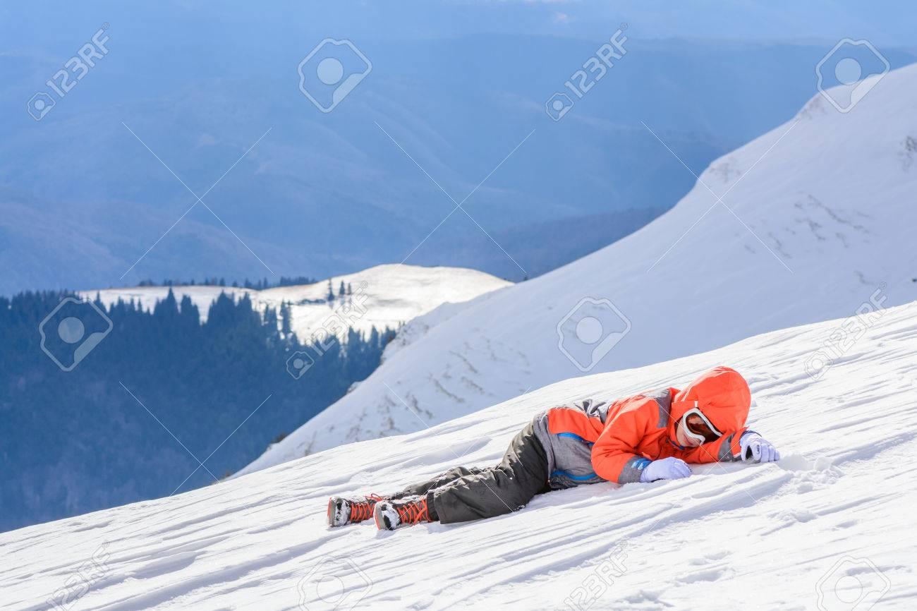 4909fefd1102 Boy Fell Down Over Fresh Snow. Happy Boy Laying On Snow. Cute ...