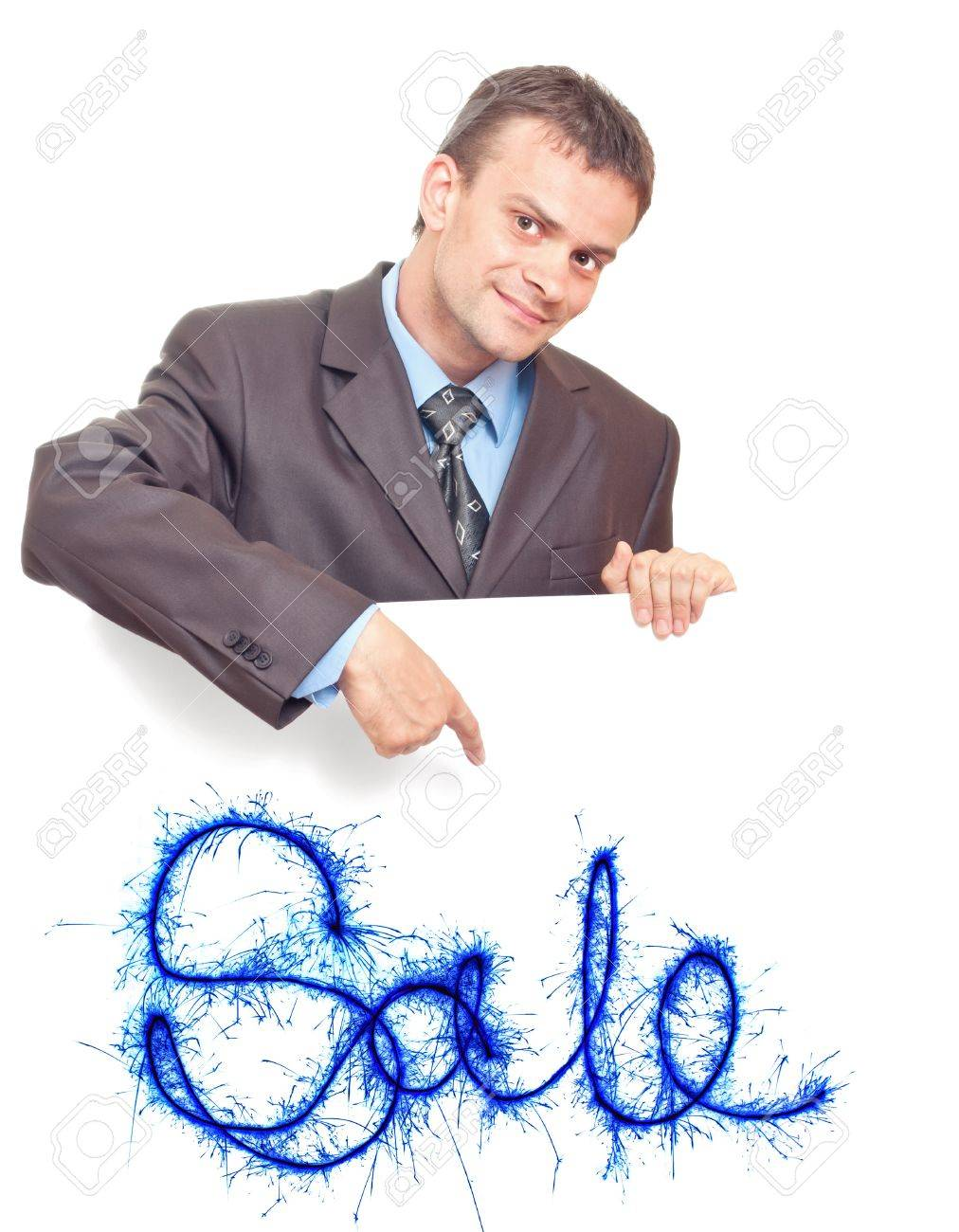 Young businessman points his finger at the white background with the words SALE Stock Photo - 9743062