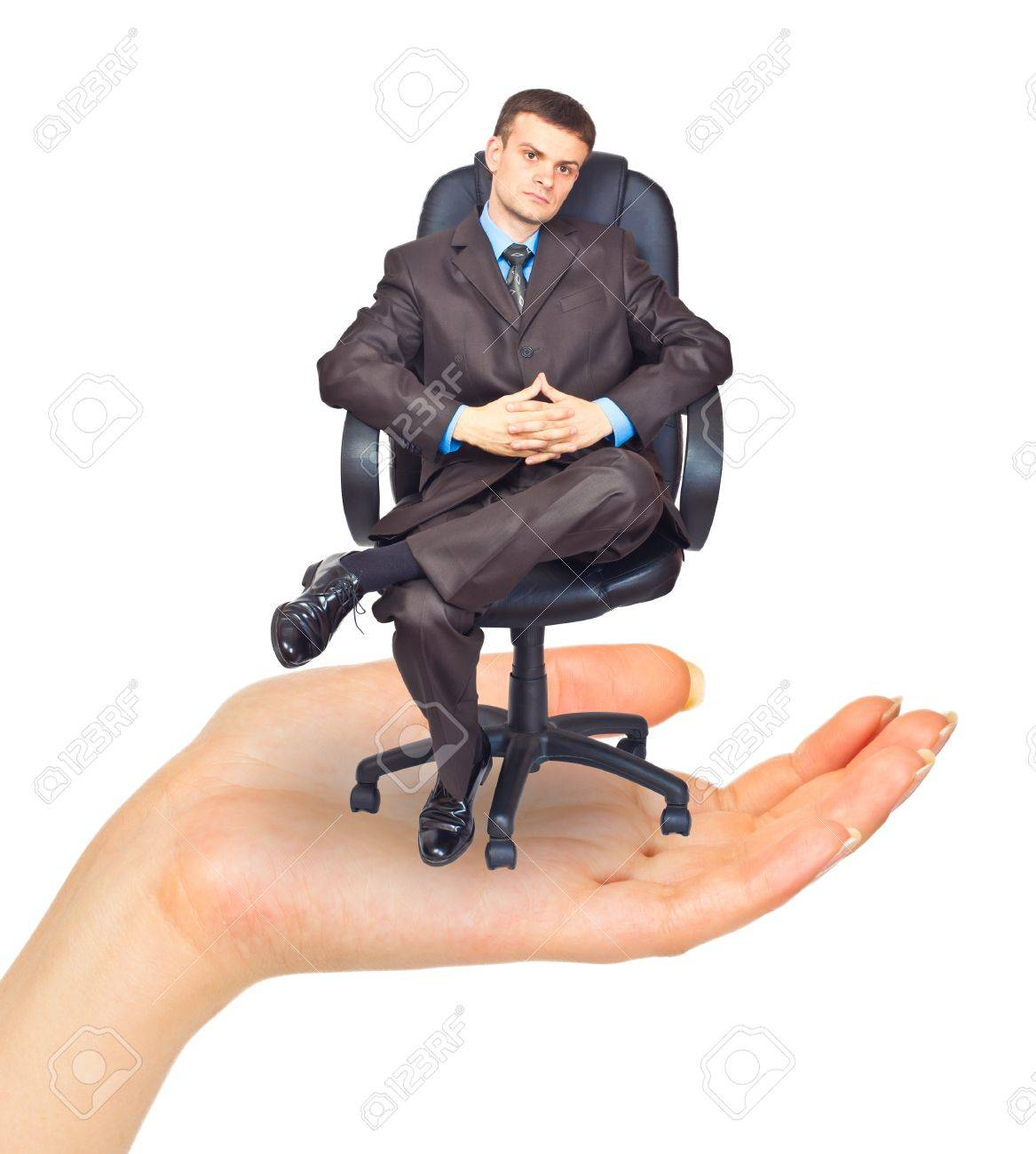 Businessman sitting on chair in hand. Isolated on white background Stock Photo - 10560897