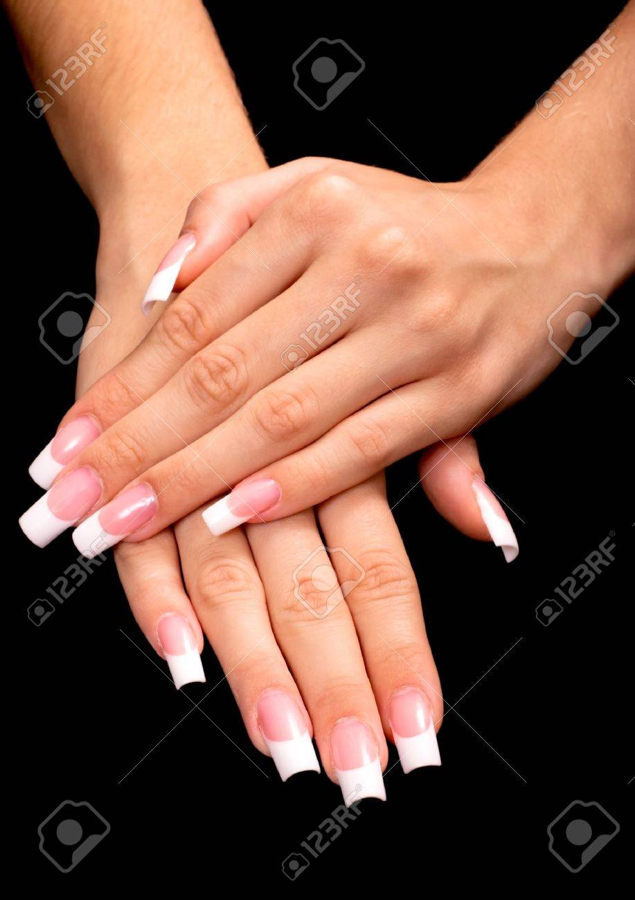 Beautiful hands with french manicure on black background Stock Photo ,  11143634