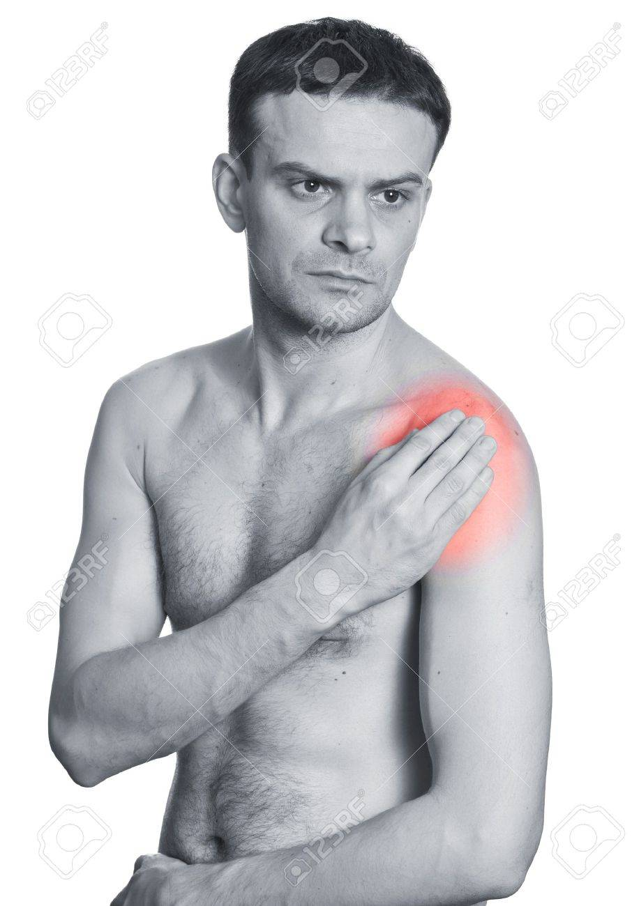 Young man holding his shoulder having ache. Isolated on white Stock Photo - 12774068