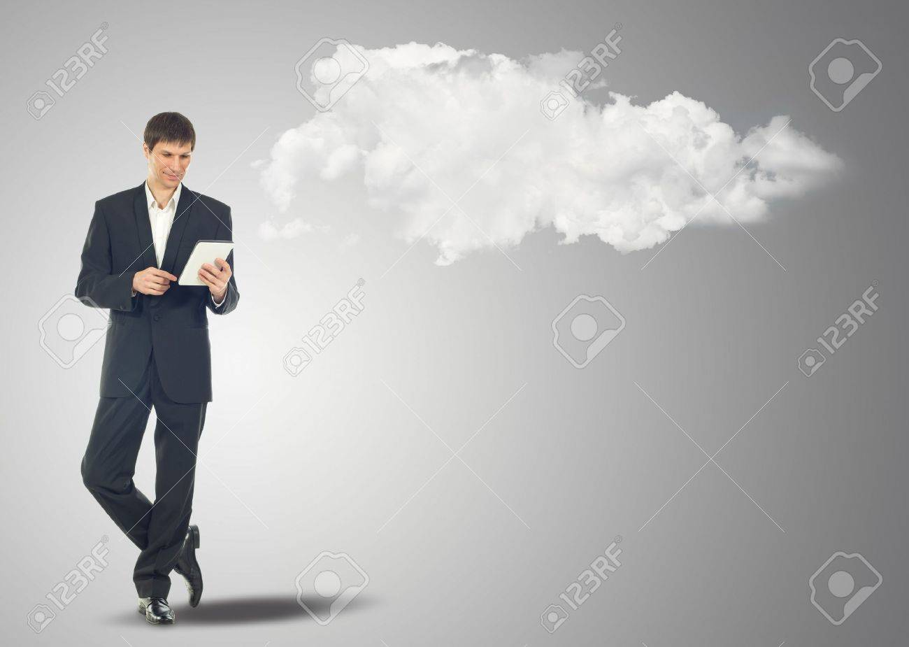 Businessman with touch screen Internet Tablet and the clouds. Maybe will used as concept cloud service Stock Photo - 15037363