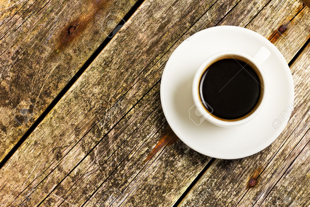 Cup Of Coffee On A Wood Table, Top View Stock Photo   15821212
