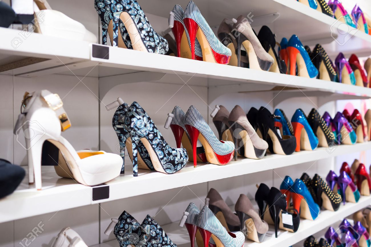 Background With Shoes On Shelves Of Shop Stock Photo Picture And