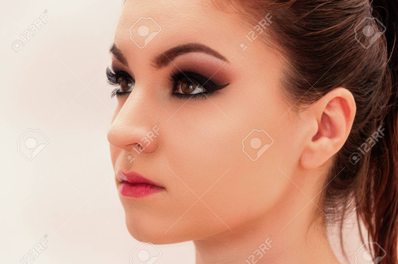 Close up shot of a young beautiful model with professional make up, on the white background - 138149718