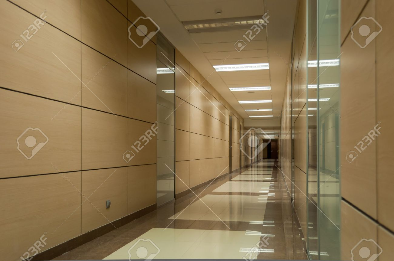 Long beige corridor in a modern office building Stock Photo - 8764761